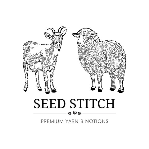 A sheep and a goat nestle nicely above the seed stitch logo.