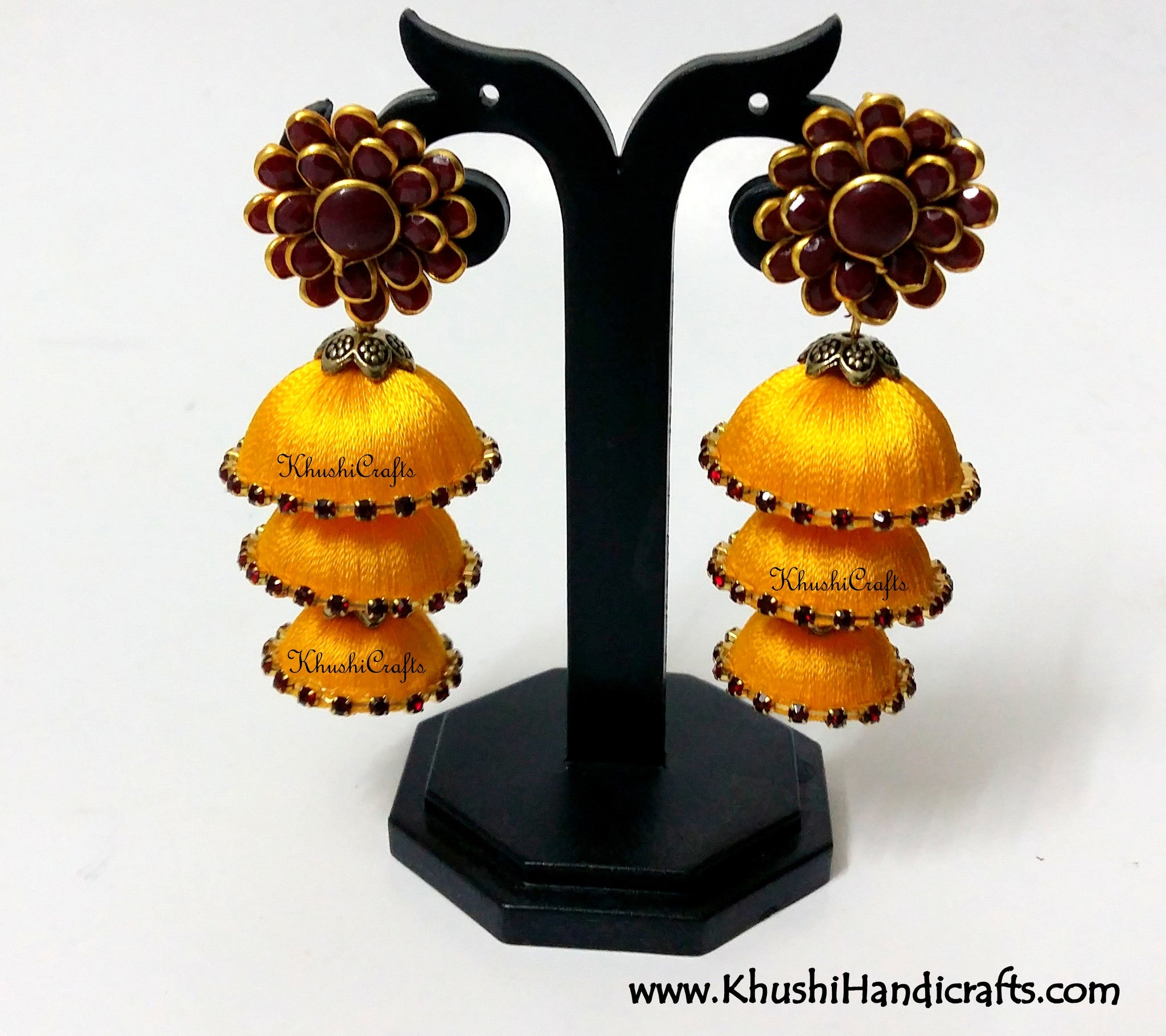 Yellow Cascaded Jhumkas in Silk with Pachi Stud