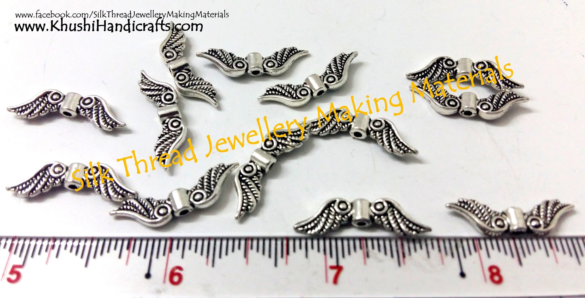 Antique silver Angel wings charms.Sold per piece! - Khushi Handmade Jewellery