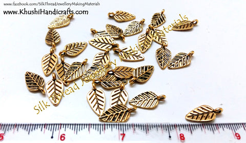 Antique Gold Leaf spacer charms.Sold as a set of 10 pieces!