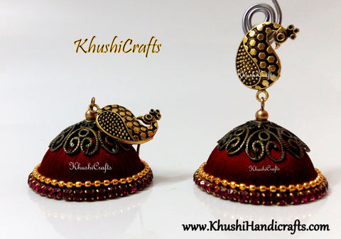 Red Designer Extra large Silk Jhumkas enhanced with a Peacock Stud
