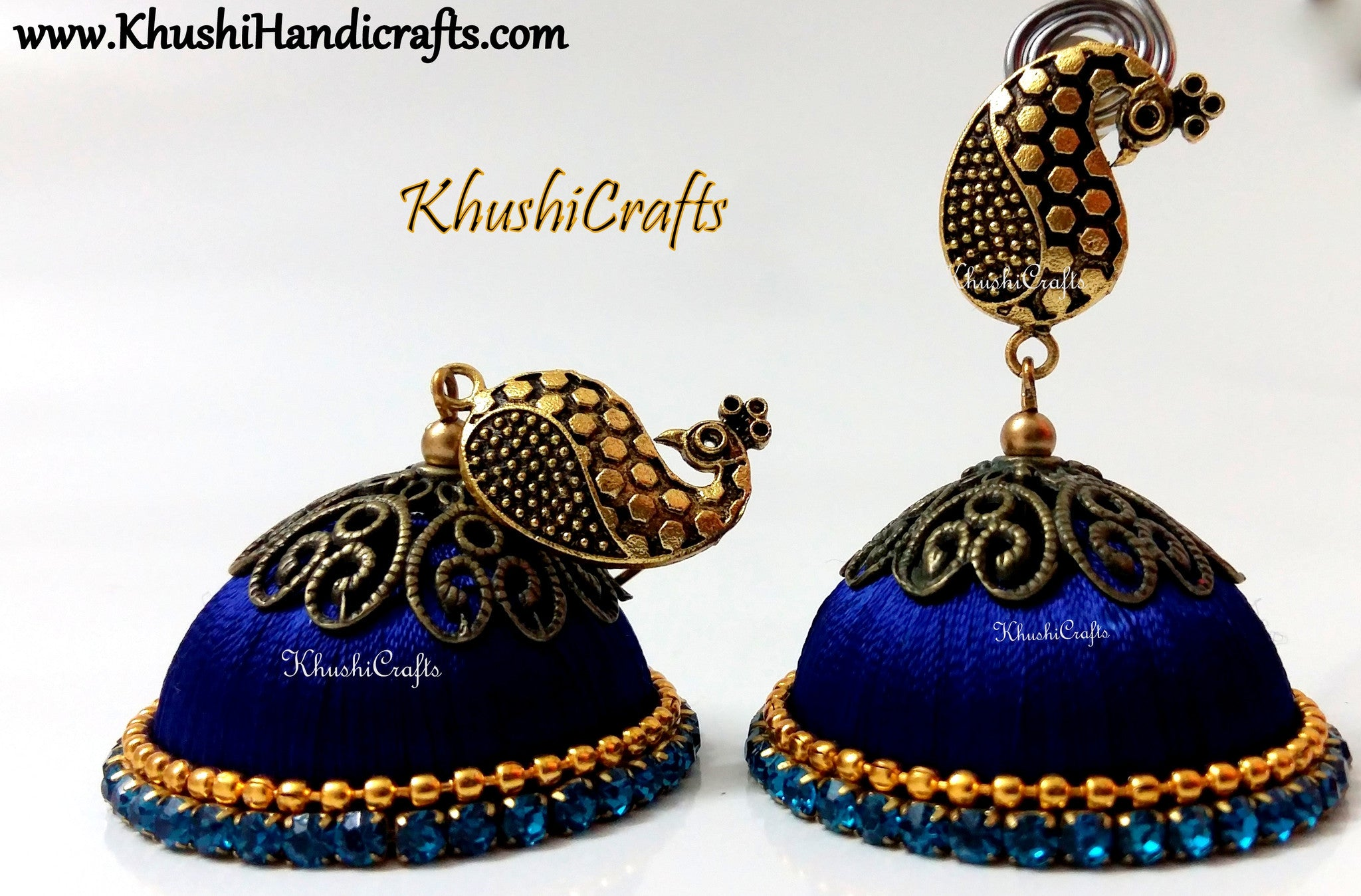 Blue Designer Extra large Silk Jhumkas enhanced with a Peacock Stud