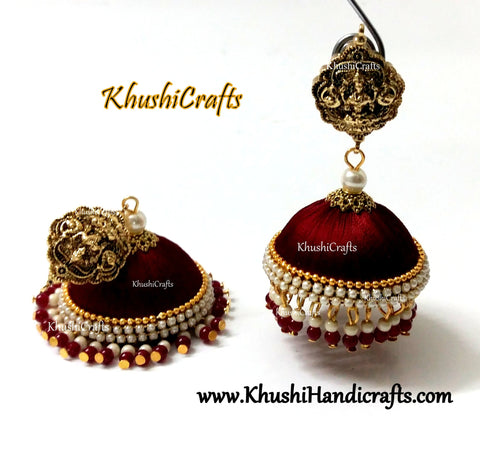 Maroon Designer Extra large Silk Jhumkas enhanced with a Lakshmi Stud and Gungaroos attached