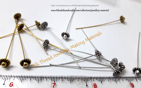 Designer Head pins in Antique Gold and Silver.Sold per pair!