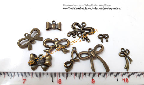 Mixed Antique Bronze Ribbon charms for Bracelet and Necklace Jewelry. Sold as a combo!