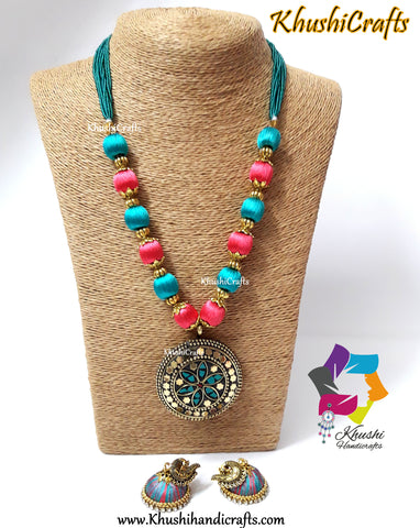 Peach and Teel silk thread Necklace set with Tibetan pendant and silk jhumkas!