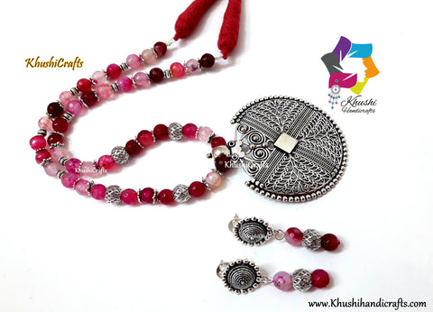 Pink Semiprecious Necklace with German silver Pendant and dangler earrings