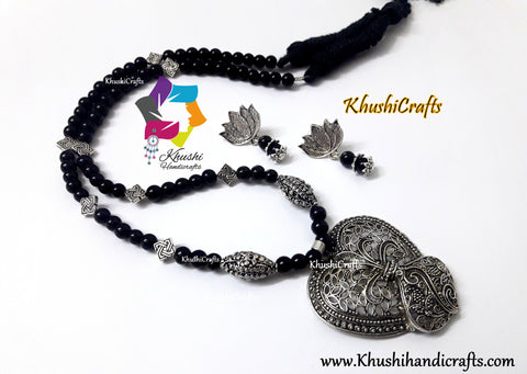 Black Glass beads Necklace with German silver Pendant and Lotus dangler earrings