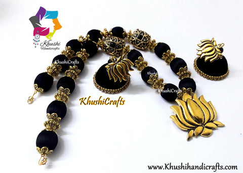Black Silk Thread Jewelry complimented with a Lotus Pendant!