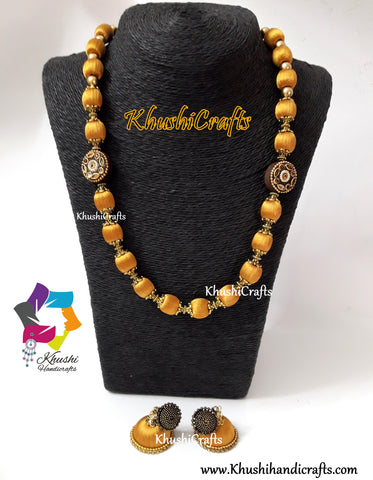 Silk Thread Jewelry in Gold shade complimented with Kundan work Wooden Moppu!