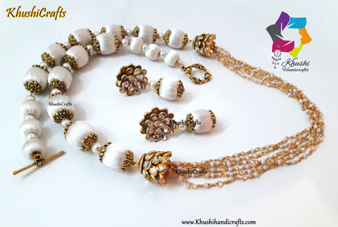 Off White Silk Thread Jewelry Set with Pearl linked chain complimented with Pachi spacers!