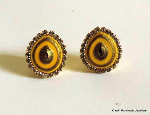 Yellow studs with stone lining