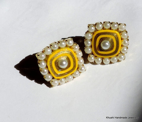 Yellow studs with pearl lining