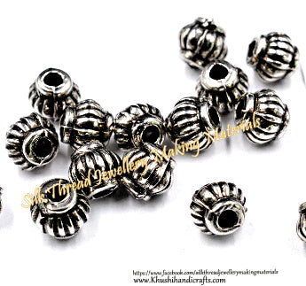 Antique silver 4 mm spacers.Sold as a set of 100 beads