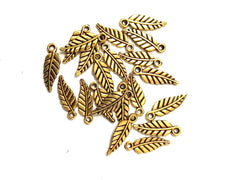 Antique Gold Leaf spacer charms Pattern 2.Sold as a set of 20 pieces!