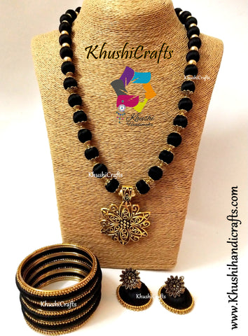 Black silk thread Necklace set with Flower Pendant and a set of bangles!