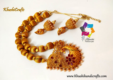 Silk thead Necklace in Gold shade with Peacock Pendant and complimentary handmade Jhumkas