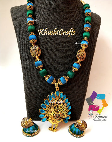 Silk thead Necklace Set in Peacock shades with Peacock Pendant and a pair of handmade Jhumkas