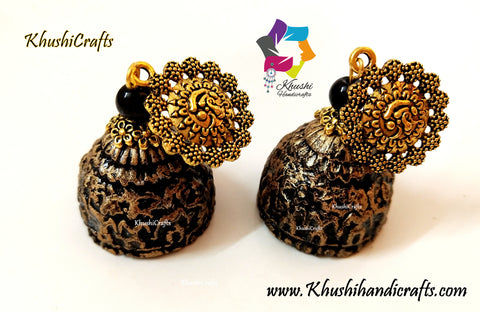 Temple Patterned Clay Jhumkas with a mettalic look!