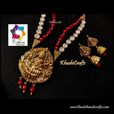Deep Red shaded Semi precious Jewelry Set with a grand Temple Jewellery Lakshmi Pendant in Antique Gold!