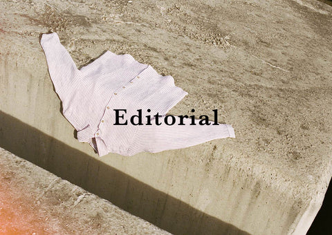 editorial cover with shirt lying on the floor