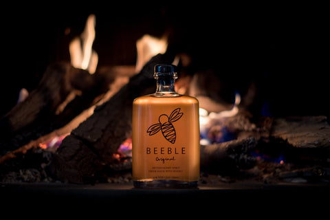 Beeble Honey Whisky next to fire