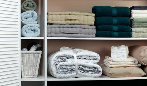 duvet covers and sheet sets in a closet