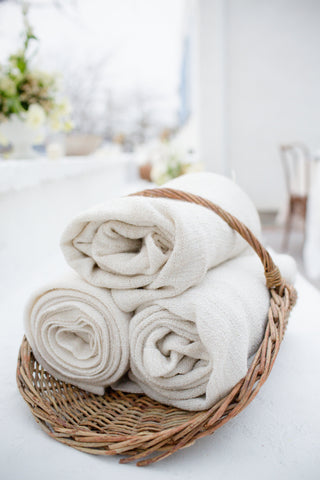 textiles blankets towels in a basket