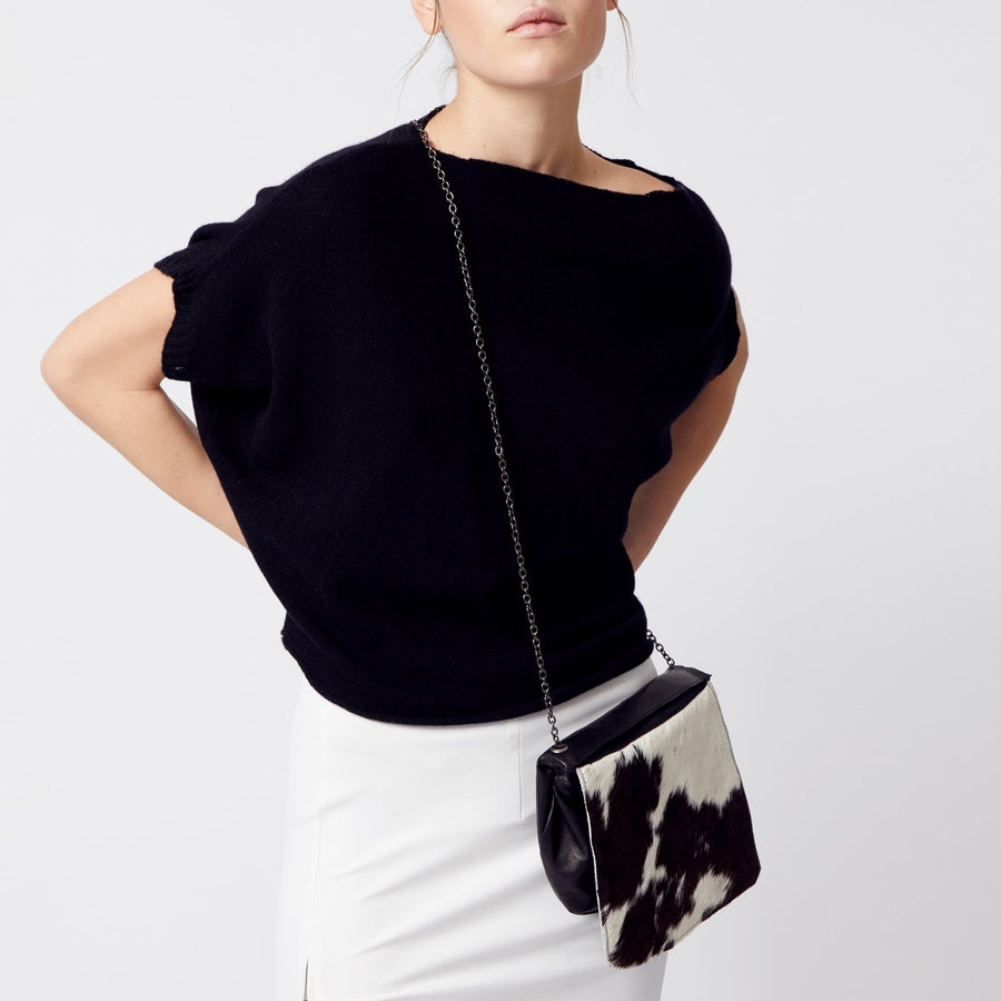black/white pony leather crossbody handbag with linen lining and adjustable chain strap by Elaine Kim