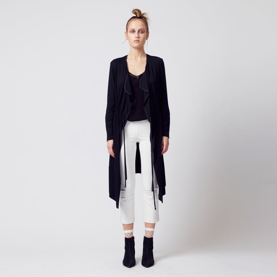 black jersey coat with drawstring waist and pockets by Elaine Kim