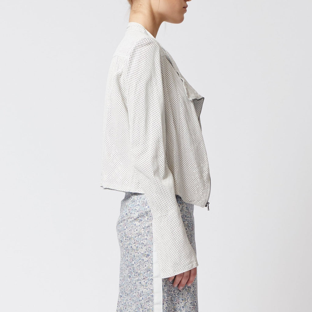 white cropped perforated leather moto jacket with side zip by Elaine Kim