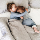 blue for boys and girls - cozy mornings in bed in roots & wings organic merino