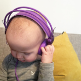 Getting the tunes on in her grey marle bodysuit from roots & wings merino