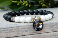 black and white bracelet with crystal charm