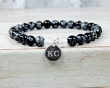 black bracelet with engraved initial charm