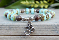 blue beaded yoga bracelet with Om charm