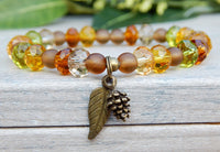 fall bracelet with leaf and pine cone charms