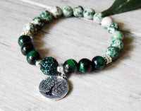 green gemstone bracelet with tree of life charm