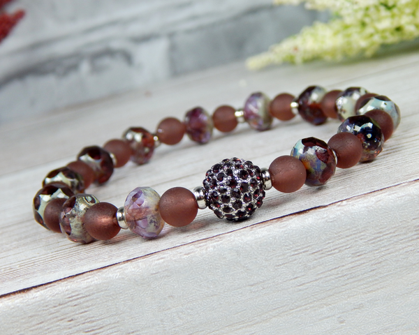 purple boho bracelet with violet and plum colors