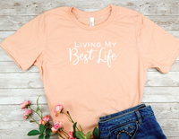 peach shirt Living My Best Life t-shirt a phrase that shows the way you live, enjoying the life you've worked so hard for,  achieving your goals and living without regret.