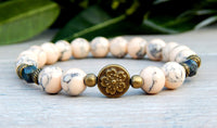 beaded flower bracelet in neutral colors