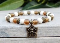 butterfly beaded brown and white bracelet