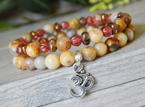 beaded stacked yoga bracelets with om charm