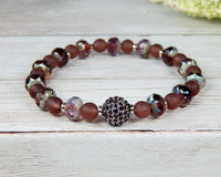 beaded boho bracelet in shades of purple and plum