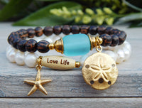ocean inspired freshwater pearl and palm wood bracelet