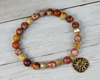 earthy red beaded bracelet sun charm