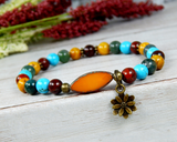 Colorful Boho Bracelet with a Lotus Flower Charm