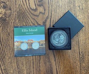Paperweight and Ellis Island Quarters