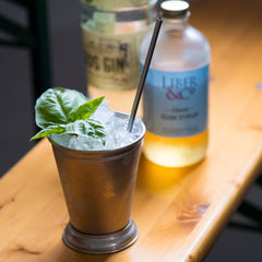 Gin Basil Julep on indoor bar with bottles