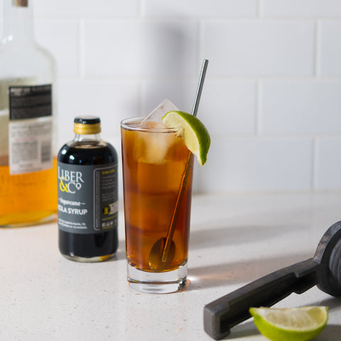 Homebar with makings of Cuba Libre cocktail